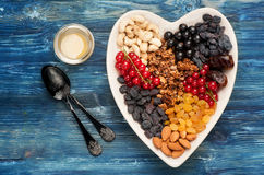 Granola, fresh berries and nuts. Stock Photography