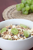 Granola with fresh grapes Stock Images