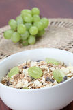 Granola with fresh grapes Royalty Free Stock Image