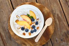 Granola with fresh organic blueberries, nectarines and almonds Royalty Free Stock Images