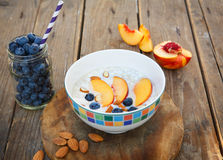 Granola with fresh organic blueberries, nectarines and almonds Royalty Free Stock Photo
