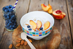 Granola with fresh organic blueberries, nectarines and almonds Stock Photos