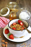 Granola with fresh strawberry - healthy breakfast. Royalty Free Stock Images