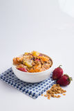 Granola with fruits salad on the white. Royalty Free Stock Images