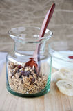 Granola in glass bottle Royalty Free Stock Image