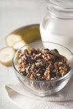 Granola in the glass bowl vertical Stock Images