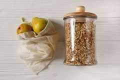 Granola in glass and eco natural bags with fruits, flat lay. plastic free items. reuse, reduce, recycle, refuse. bulk store. Sustainable lifestyle concept royalty free stock photo