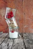 Granola in glass with yogurt and raspberry Royalty Free Stock Photography