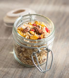 Granola with goji berries, almond nuts, peanuts, oat flakes, honey in jar Royalty Free Stock Photos