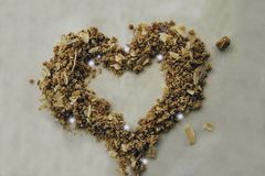 Granola Heart For Health. Heart shape made out of granola and coconut flakes Royalty Free Stock Photo
