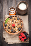 granola, honey and berries Royalty Free Stock Images