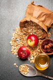 Granola, honey, nuts and fresh apples. Royalty Free Stock Photography