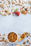 Granola and ingredients - oats, various nuts and honey stock photo