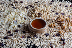 Granola ingredients from side with honey Royalty Free Stock Images