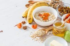 Granola ingredients on white wood background Stock Photos