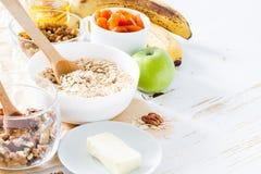 Granola ingredients on white wood background Stock Photo