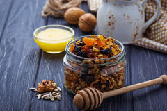 Granola in jar with nuts and dried fruit. Selective focus Royalty Free Stock Image