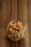 Granola in jar with packing-twine on wooden background with spac Stock Photos