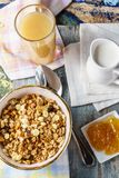 Granola with lemon jam and fresh juice. Royalty Free Stock Photography