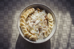 Granola with low-fat yogurt, banana honey and cinamon. Royalty Free Stock Image