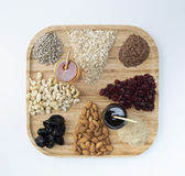 Granola. Making materials on wooden plate stock photo