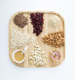 Granola. Making materials on wooden plate royalty free stock images