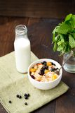 Granola with milk. Berries and nuts Stock Photo