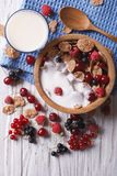 Granola with milk and fresh berries close up vertical top view Royalty Free Stock Photos