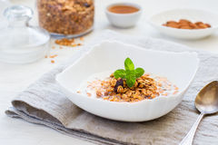 Granola with milk, honey and nuts on a white background. healthy Stock Photos