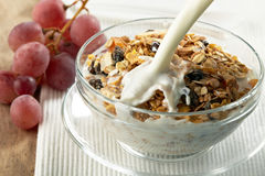 Granola and milk splash Stock Image