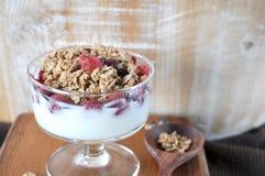 Granola Mixed Dried Berry in Yogurt Glass Stock Photo