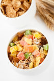 Granola (muesli flakes) with dried fruit in a bowl and ears of wheat Stock Photography