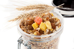 Granola (muesli flakes) with dried fruit in a glass jar on a white background Stock Images