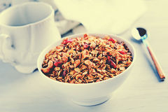 Granola (or muesli) with nuts and dried fruits in bowl, retro style Royalty Free Stock Images