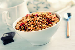 Granola (or muesli) with nuts and dried fruits in bowl, retro style Stock Photo