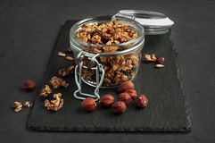 Granola, muesli with nuts in a glass jar royalty free stock photo