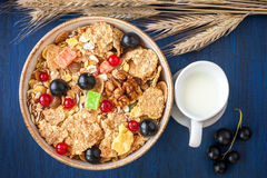 Granola ( muesli ) with red and black currants and milk in a jug Royalty Free Stock Image
