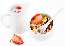Granola (muesli) with strawberries, dried fruit and milk. Healthy Breakfast Stock Images