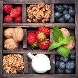 Granola, nuts, berries, honey, milk.  Collage. Royalty Free Stock Images