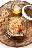 Granola with nuts and honey in glass jar Royalty Free Stock Images