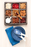 Granola, oatmeal, nuts, berries in a wooden box. top view Stock Photos