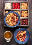 Granola, oatmeal, nuts, dried berries and honey in wooden box. Breakfast products Stock Images