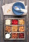 Granola, oatmeal, nuts and dried berries in wooden box. Breakfast products Stock Photography