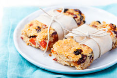 Granola, oatmeal, oat bars with dried cranberry and raisin on a white and blue background. Healthy breakfast Royalty Free Stock Photos