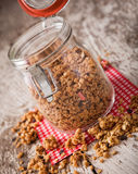 Granola in open glass jar Stock Image