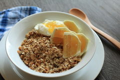 Granola. With oranges and milk Royalty Free Stock Images