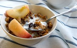 Granola&Peach. A bowl of Granola with Peach slices Royalty Free Stock Photography
