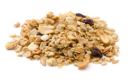Granola. Pile of granola cereal with raisins and nuts isolated on white royalty free stock photography