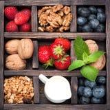 Granola, porcas, bagas, mel, leite collage Imagens de Stock Royalty Free