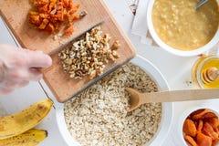 Granola preparation, white wood background Stock Images